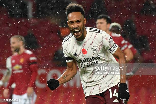 Arsenal's Gabonese striker Pierre-Emerick Aubameyang celebrates after scoring the opening goal from the penalty spot during the English Premier...