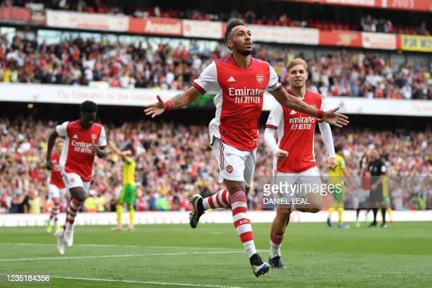 Arsenal's Gabonese striker Pierre-Emerick Aubameyang celebrates after he scores his team's opening goal during the English Premier League football...