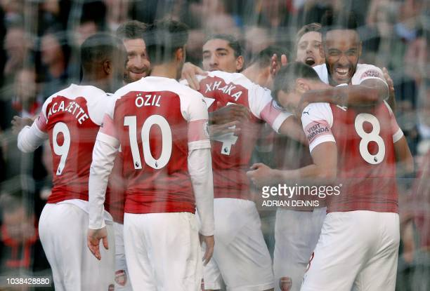 Arsenal's Gabonese striker PierreEmerick Aubameyang celebrates scoring his team's second goal during the English Premier League football match...
