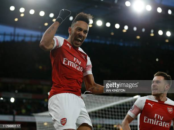 Arsenal's Gabonese striker PierreEmerick Aubameyang celebrates scoring their second goal from the penalty spot during the English Premier League...