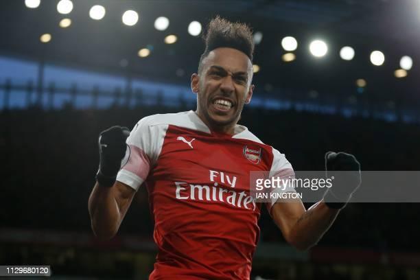 TOPSHOT Arsenal's Gabonese striker PierreEmerick Aubameyang celebrates scoring their second goal from the penalty spot during the English Premier...