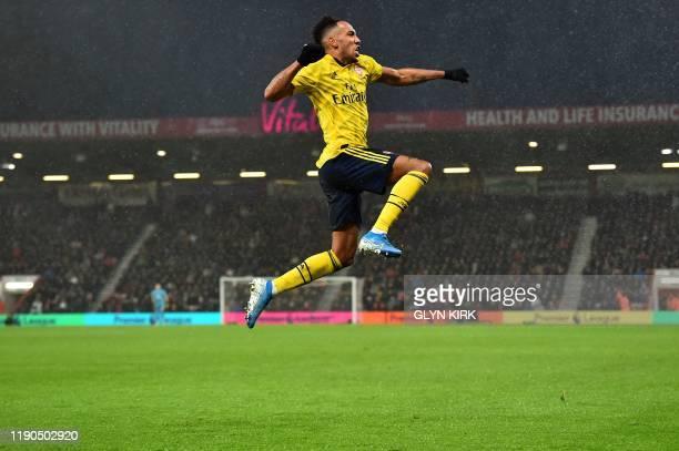 Arsenal's Gabonese striker PierreEmerick Aubameyang celebrates scoring his team's first goal during the English Premier League football match between...