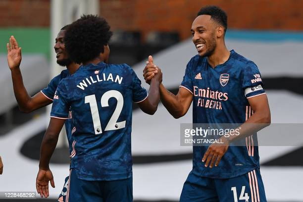 Arsenal's Gabonese striker Pierre-Emerick Aubameyang celebrates scoring their third goal with Arsenal's Brazilian midfielder Willian during the...