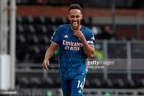 Arsenal's Gabonese striker Pierre-Emerick Aubameyang celebrates scoring their third goal during the English Premier League football match between...