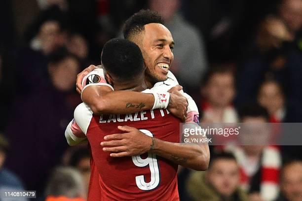 Arsenal's Gabonese striker PierreEmerick Aubameyang celebrates with Arsenal's French striker Alexandre Lacazette after scoring their third goal...