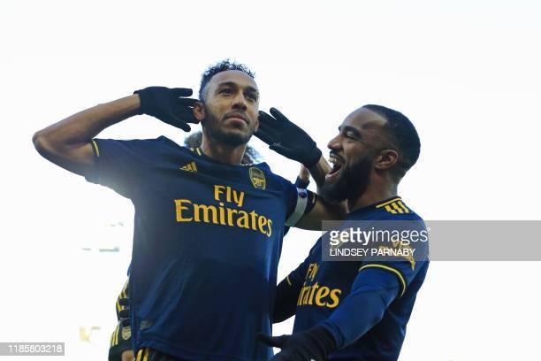 TOPSHOT Arsenal's Gabonese striker PierreEmerick Aubameyang celebrates with Arsenal's French striker Alexandre Lacazette after scoring their first...