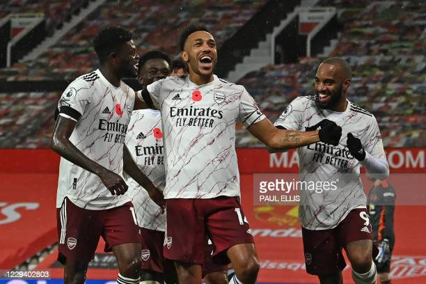 Arsenal's Gabonese striker Pierre-Emerick Aubameyang celebrates with teammates after scoring the opening goal from the penalty spot during the...
