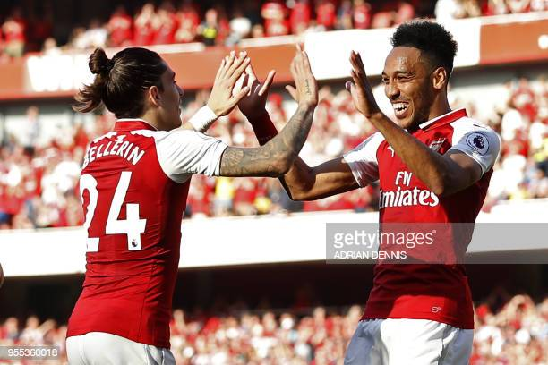 Arsenal's Gabonese striker PierreEmerick Aubameyang celebrates with Arsenal's Spanish defender Hector Bellerin after scoring their fifth goal during...