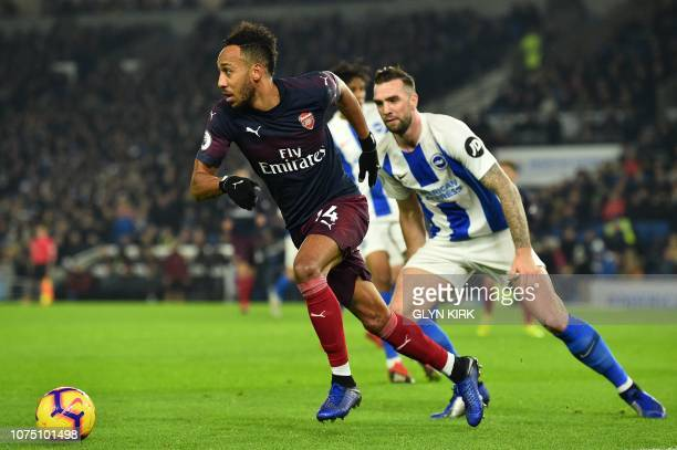 Arsenal's Gabonese striker PierreEmerick Aubameyang chases the ball during the English Premier League football match between Brighton and Hove Albion...