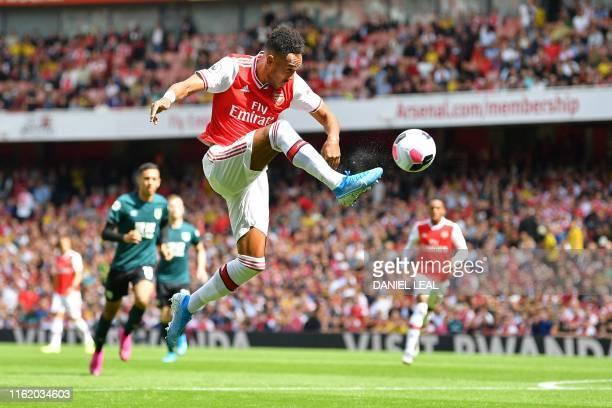 Arsenal's Gabonese striker Pierre-Emerick Aubameyang controls the ball during the English Premier League football match between Arsenal and Burnley...