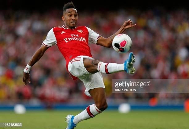 Arsenal's Gabonese striker PierreEmerick Aubameyang controls the ball during the English Premier League football match between Arsenal and Tottenham...