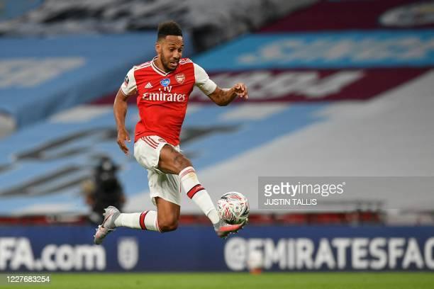 Arsenal's Gabonese striker PierreEmerick Aubameyang controls the ball during the English FA Cup semifinal football match between Arsenal and...