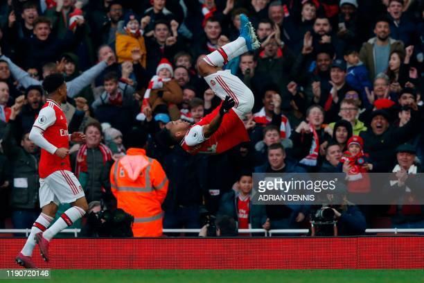 TOPSHOT Arsenal's Gabonese striker PierreEmerick Aubameyang does a somersault as he celebrates scoring the opening goal during the English Premier...