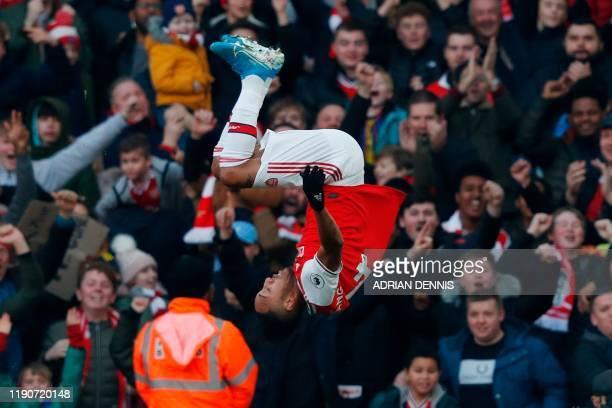 Arsenal's Gabonese striker PierreEmerick Aubameyang does a somersault as he celebrates scoring the opening goal during the English Premier League...
