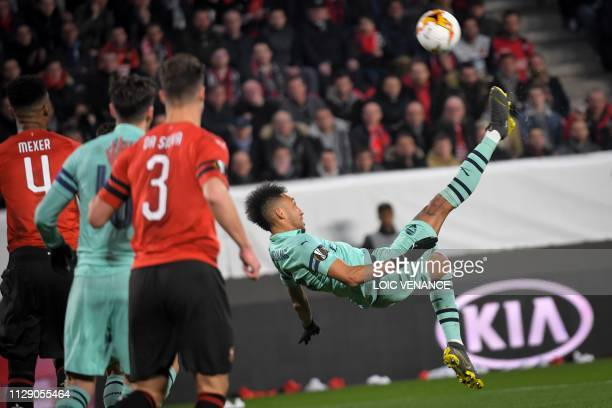 Arsenal's Gabonese striker PierreEmerick Aubameyang executes a bicycle kick during the UEFA Europa League round of 16 first leg football match...