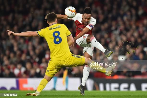 Arsenal's Gabonese striker PierreEmerick Aubameyang has this shot blocked by BATE Borisov's Belarusian midfielder Stanislav Dragun during the UEFA...