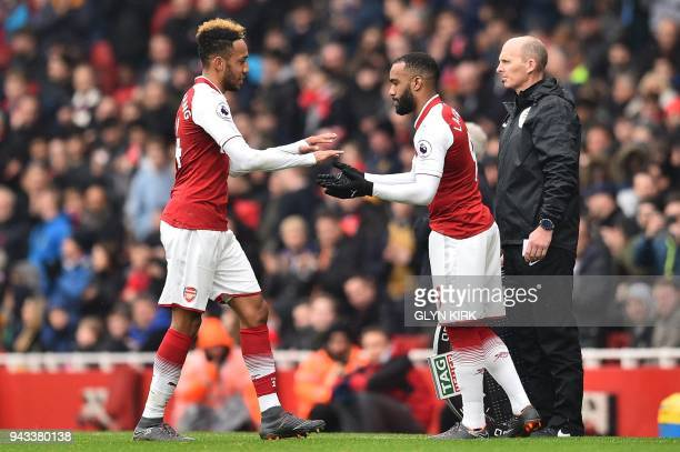 Arsenal's Gabonese striker PierreEmerick Aubameyang is substituted by Arsenal's French striker Alexandre Lacazette during the English Premier League...