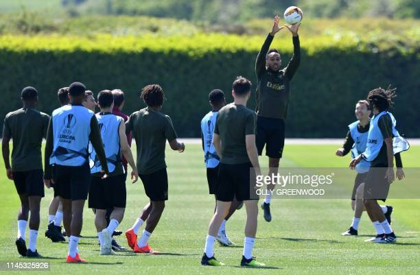 Arsenal's Gabonese striker Pierre-Emerick Aubameyang jumps to catch the ball duting a team training session at Arsenal's London Colney training...