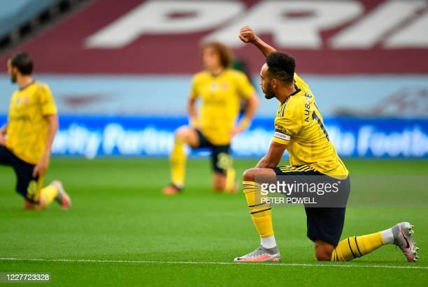 Arsenal's Gabonese striker Pierre-Emerick Aubameyang kneels during the English Premier League football match between Aston Villa and Arsenal at Villa...