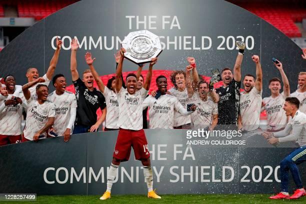 Arsenal's Gabonese striker Pierre-Emerick Aubameyang lifts the trophy after winning the English FA Community Shield football match between Arsenal...