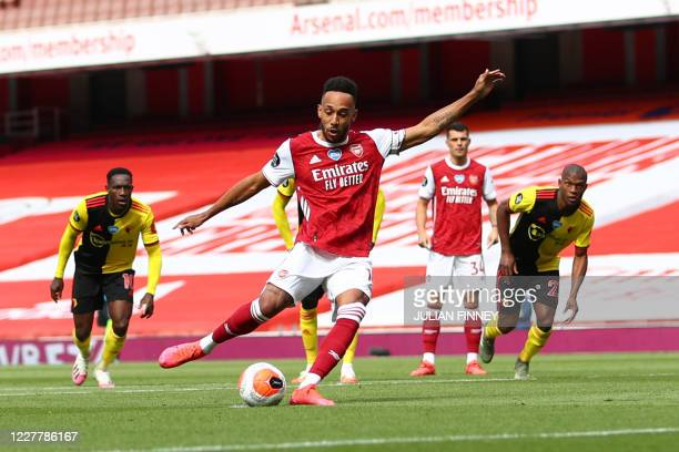 Arsenal's Gabonese striker Pierre-Emerick Aubameyang scores a penalty during the English Premier League football match between Arsenal and Watford at...