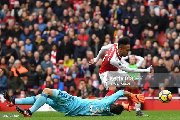 TOPSHOT Arsenal's Gabonese striker PierreEmerick Aubameyang scores Arsenal's second goal past the outstretched arms of Watford's Greek goalkeeper...