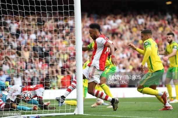 Arsenal's Gabonese striker Pierre-Emerick Aubameyang scores his team's opening goal during the English Premier League football match between Arsenal...