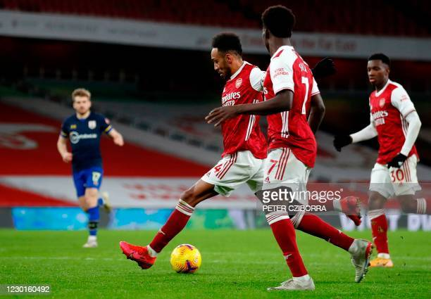 Arsenal's Gabonese striker Pierre-Emerick Aubameyang scores the equalising goal during the English Premier League football match between Arsenal and...