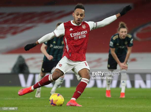 Arsenal's Gabonese striker Pierre-Emerick Aubameyang shoots from the penalty spot to score his team's second goal during the English Premier League...
