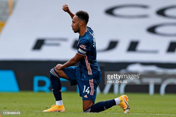 Arsenal's Gabonese striker Pierre-Emerick Aubameyang takes a knee in support of the Black Lives Matter campaign against rasicm before kick off of the...