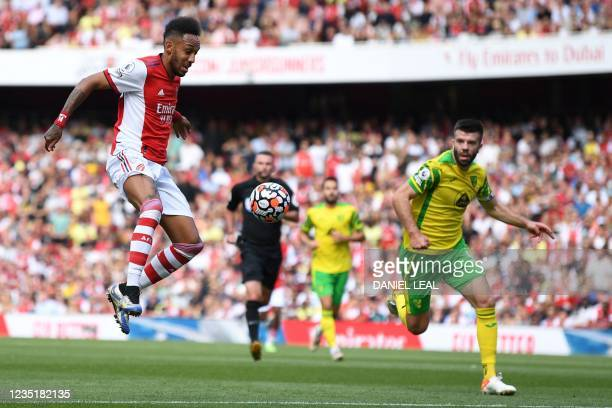 Arsenal's Gabonese striker Pierre-Emerick Aubameyang takes a shot during the English Premier League football match between Arsenal and Norwich City...