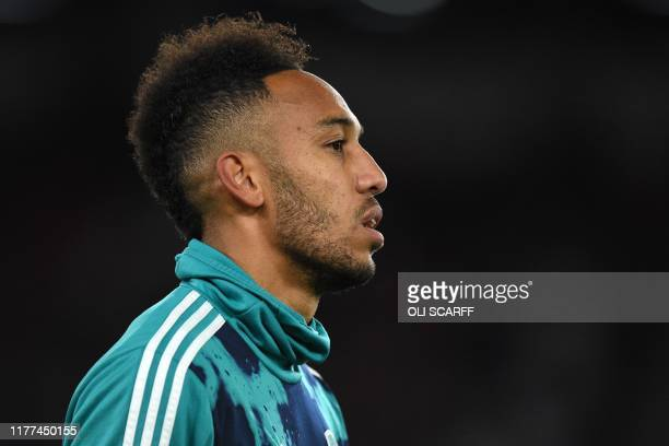 Arsenal's Gabonese striker PierreEmerick Aubameyang warms up ahead of the English Premier League football match between Sheffield United and Arsenal...