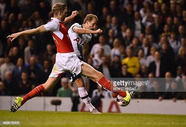 Arsenal's German defender Per Mertesacker vies with Tottenham Hotspur's English striker Harry Kane during the English League Cup third round football...