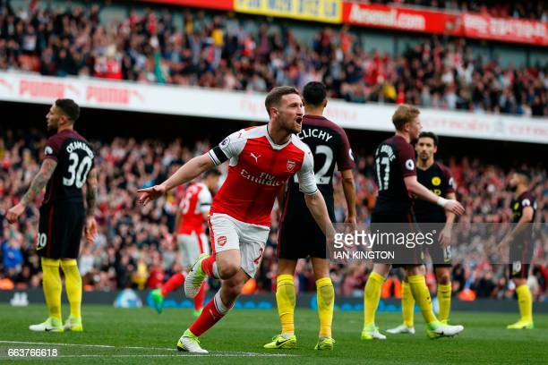 Arsenal's German defender Shkodran Mustafi celebrates after scoring their second goal during the English Premier League football match between...