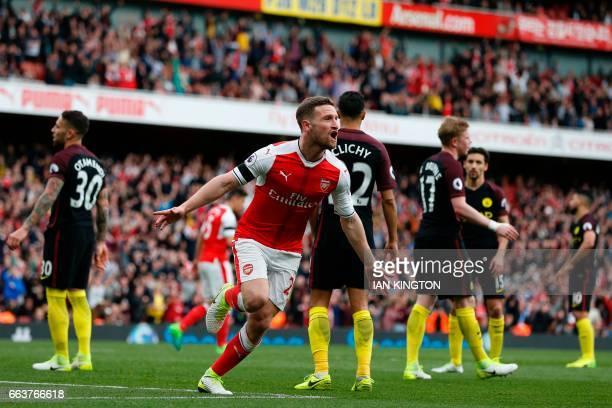 Arsenal's German defender Shkodran Mustafi celebrates after scoring their second goal during the English Premier League football match between...