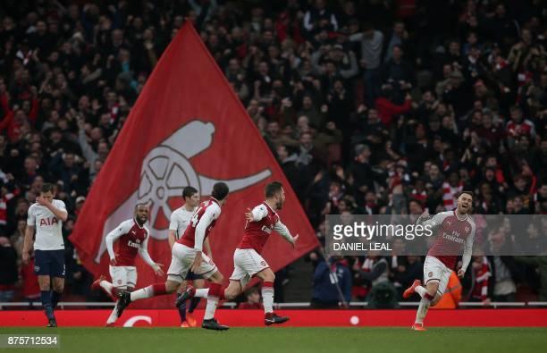 Arsenal's German defender Shkodran Mustafi celebrates scoring his team's first goal during the English Premier League football match between Arsenal...