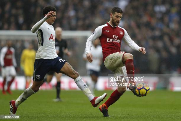 Arsenal's German defender Shkodran Mustafi fends off Tottenham Hotspur's English midfielder Dele Alli during the English Premier League football...