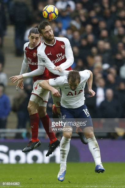 Arsenal's German defender Shkodran Mustafi heads the ball during the English Premier League football match between Tottenham Hotspur and Arsenal at...