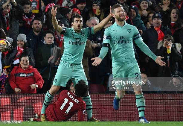 Arsenal's German defender Shkodran Mustafi reacts after English referee Michael Oliver awarded Liverpool's Egyptian midfielder Mohamed Salah a...