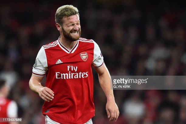 Arsenal's German defender Shkodran Mustafi reacts after picking up an injury during the UEFA Europa League Group F football match between Arsenal and...