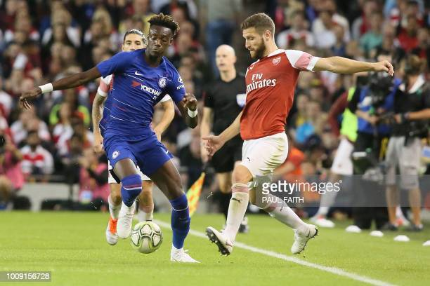 Arsenal's German defender Shkodran Mustafi vies with Chelsea's English forward Callum HudsonOdoi during the International Champions Cup football...