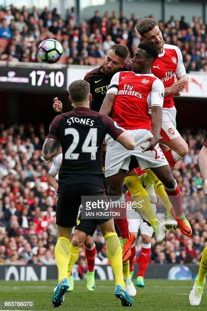 Arsenal's German defender Shkodran Mustafi wins a header to score Arsenal's second goal during the English Premier League football match between...