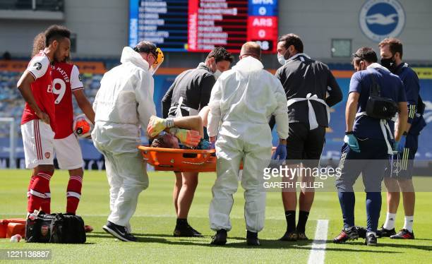 Arsenal's German goalkeeper Bernd Leno is carry away on a stretcher by medical staff during the English Premier League football match between...