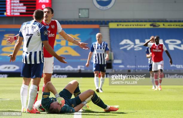 Arsenal's German goalkeeper Bernd Leno lies on the ground during the English Premier League football match between Brighton and Hove Albion and...