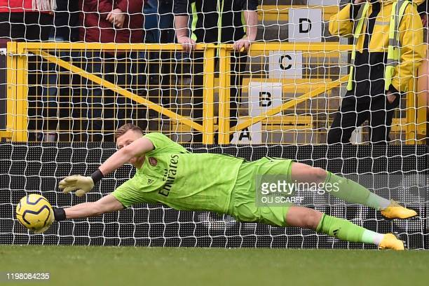 Arsenal's German goalkeeper Bernd Leno makes a save during the English Premier League football match between Burnley and Arsenal at Turf Moor in...