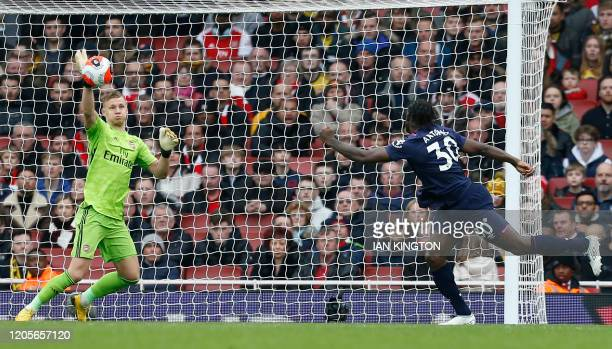 Arsenal's German goalkeeper Bernd Leno makes a save from West Ham United's English midfielder Michail Antonio during the English Premier League...