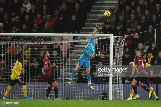 TOPSHOT Arsenal's German goalkeeper Bernd Leno punches the ball clear during the English Premier League football match between Bournemouth and...