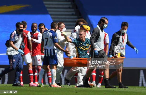 Arsenal's German goalkeeper Bernd Leno remonstrates with Brighton's French striker Neal Maupay after the keeper was injured during the English...
