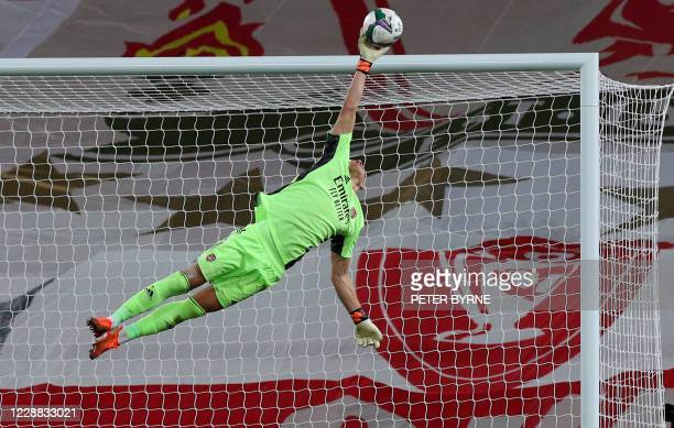 Arsenal's German goalkeeper Bernd Leno saves a shot from Liverpool's Portuguese striker Diogo Jota during the English League Cup fourth round...