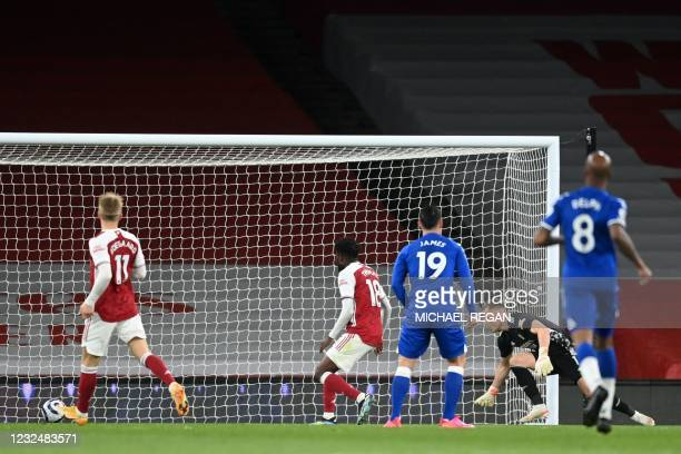 Arsenal's German goalkeeper Bernd Leno watches after deflecting the ball into his own het for an own-goal during the English Premier League football...